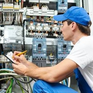 21716818-young-adult-electrician-builder-engineer-inspecting-electric-counter-equipment-in-distribution-fuse-